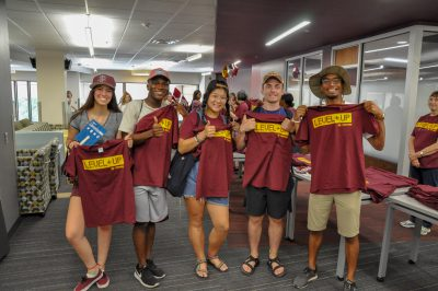 Group of students with t-shirts at the Library.